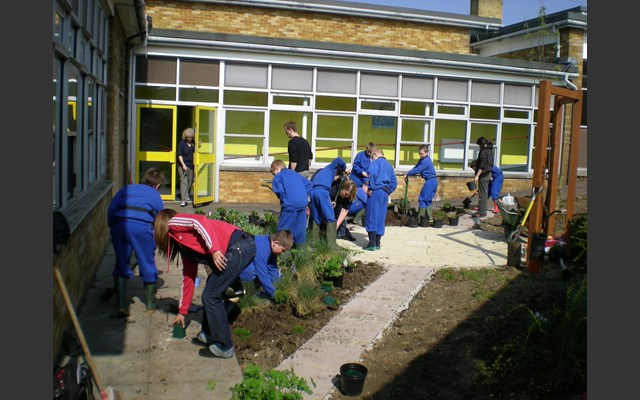 Planting with children at Wells Park School